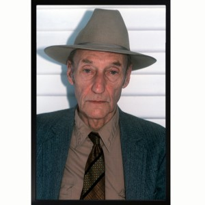 A color photo Bill Burroughs in full gangster mode.