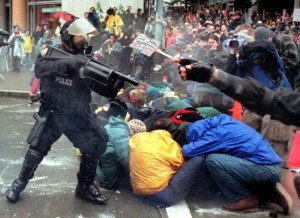 Photo of police threatening protestors in Seattle, 1999.