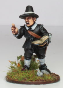 Undran halflings look a bit like this illustration of a short puritan, only dark skinned.